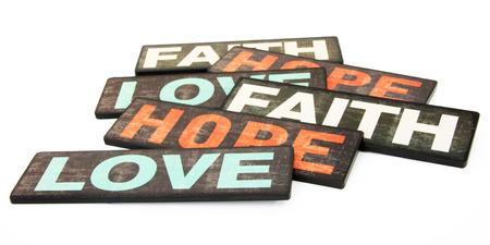 geloof hoop liefde: Geloof, Hoop & Liefde, die op Witte Achtergrond Stockfoto