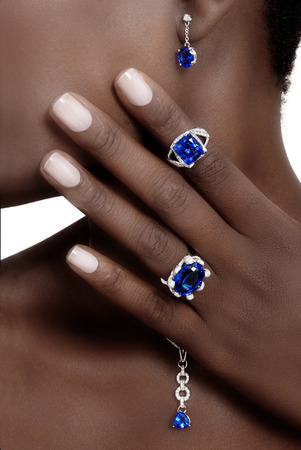silver jewellery: Tanzanite and Diamonds Designer Jewellery on the Skin of a Black Lady Stock Photo