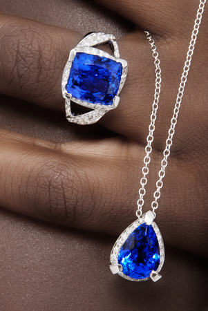 tanzanite: Tanzanite and Diamonds Designer Jewellery on the Skin of a Black Lady Stock Photo