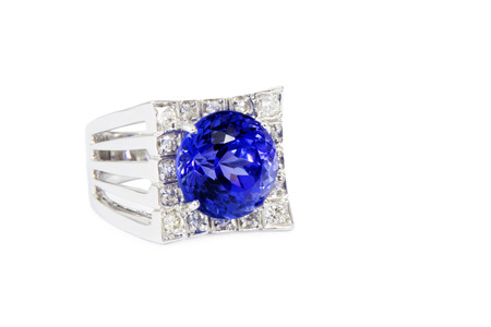 tanzanite: Designer Ring with Diamonds and Tanzanite, Side View, Isolated on White Background Stock Photo