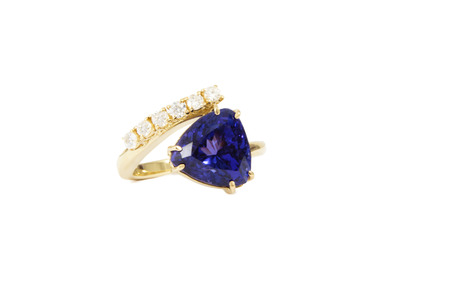 tanzanite: Designer Ring with Tanzanite Stone and Diamonds, Isolated on White Background Stock Photo