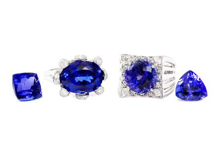 tanzanite: Two Different Ladies Rings with Tanzanite and Diamonds and two Tanzanite Stones, Designer Jewellery, Isolated on White Background