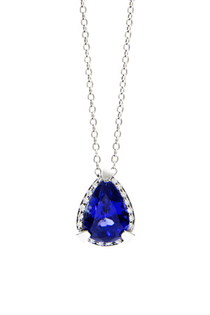 tanzanite: Ladies Pendant with Tanzanite and Diamonds, Isolated on White Background Stock Photo