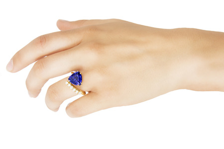 tanzanite: Hand with Designer Ring of Tanzanite, Diamonds and Gold, Isolated on White Background