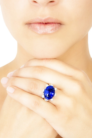 tanzanite: Closeup of a Model Wearing a Tanzanite Designer Ring, Isolated on White Stock Photo