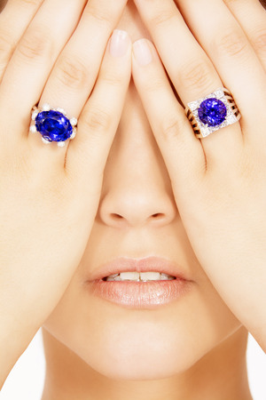 tanzanite: Closeup of a Model Wearing two Tanzanite Designer Rings, Isolated on White Stock Photo