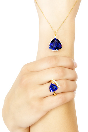 Closeup of a Model Wearing a Tanzanite Designer Ring and Pendant, Isolated on White Stock Photo