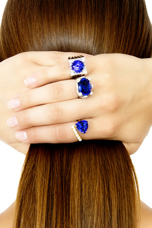 tanzanite: Closeup of a Model Wearing Tanzanite Designer Rings, Isolated on White