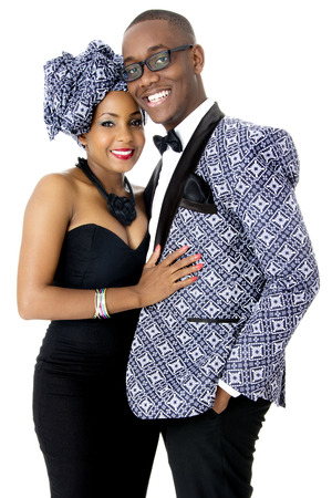 Beautiful Couple Dressed in Traditional African Clothes, in Studio, Over White photo