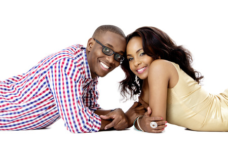 Young African Couple Lying Together on the Floor, Studio Shot, Isolated on White photo