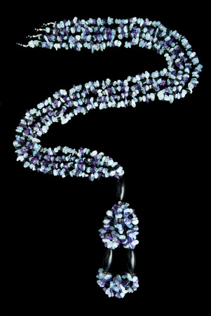 Necklace with Purple, Blue,  and Black Stones, on Black Background photo