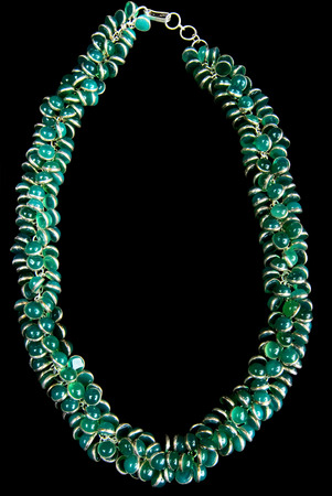 green gemstones: Necklace with Green Gemstones and Gold, Isolated on Black Background