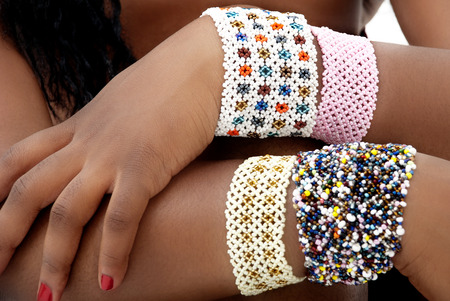 Multiple Beaded Bracelets on the Arms of a Black African Woman photo