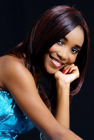 Beautiful African Female Model, Wearing Blue Dress, Isolated on Black Background photo