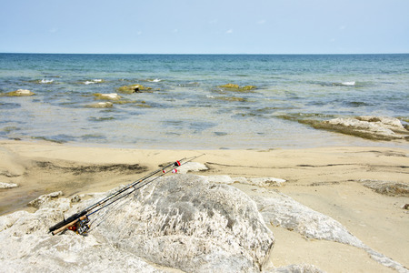 Family\'s Fishing Rods on the Rocks next to Lake Malawi, Africa Stock Photo