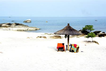 Beautiful Beach with African Umbrella on Lake Malawi, Africa Stock Photo