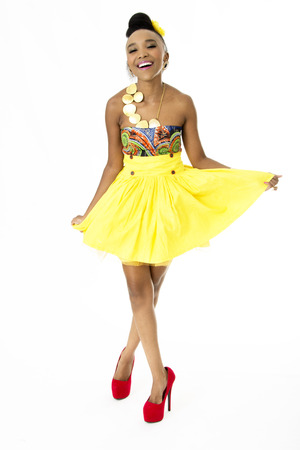 Full-Length Picture of Beautiful African Model Wearing a Modern Traditional Designer Dress Stock Photo