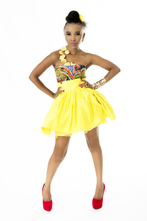 stilletto: Full-Length Picture of Beautiful African Model Wearing a Modern Traditional Designer Dress Stock Photo