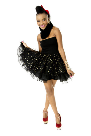 Full-length Studio Photo of Beautiful African Female Model in Modern Black Dress, on White Background photo