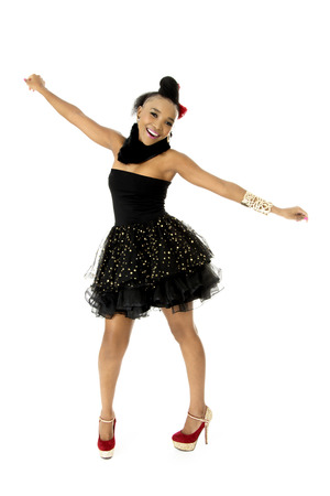 Full-length Studio Photo of Beautiful African Female Model in Modern Black Dress, on White Background Stock Photo