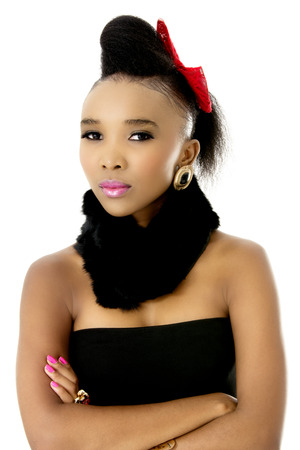 Closeup Studio Photo of Beautiful African Female Model in Modern Black Dress with Black Scarf, on White Background Stock Photo