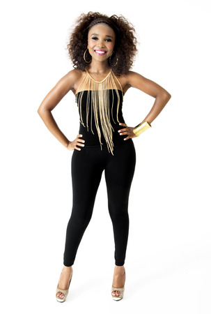 Full-length Photo of Beautiful African Female Model, Big Smile, Afro Hairstyle, Wearing Tight Black Clothes, and Golden Jewellery, Isolated on White Background