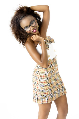 Beautiful, Happy African Female Model Wearing Cute Tartan Dress, Big Afro Hairstyle, Spectacles,Pink Lips, with a  Smile, Isolated on White Background