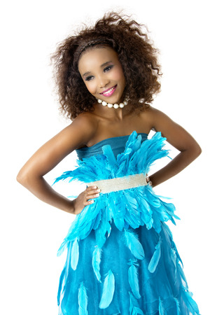 Beautiful African Female Model in Playful Mood, Wearing Turquoise Feathered Designer Dress, Silver Shining Belt, Big Afro Hairstyle, White Beaded Necklace, Isolated on White Background
