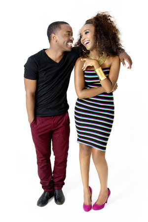 FullLength Picture of Attractive African Couple Having Fun Together in the Studio Looking at Each Other Laughing Isolated on White Background