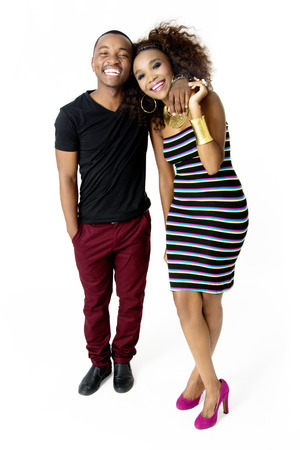 sexy couple black background: FullLength Picture of Attractive African Couple Having Fun in the Studio Holding Each Other Laughing Together Isolated on White Background Stock Photo