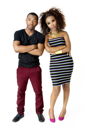 FullLength Picture of Attractive African Couple Standing Next to Each Other Shoulders Touching Serious and Angry in the Studio Isolated on White Background