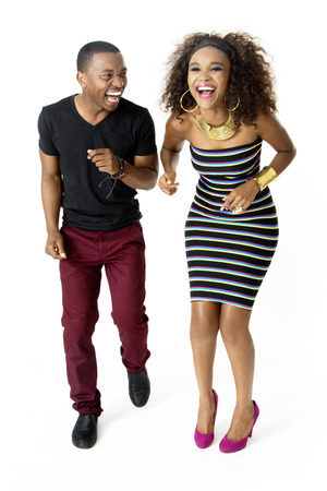 woman screaming: FullLength Picture of Attractive African Couple Dancing Shouting and Laughing Together in the Studio Isolated on White Background