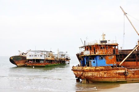 Rusted Shipwrecks on the Beach since 1975 at the 'ship graveyard' of Barro Do Dande, Angola, Southern Africa Stock Photo
