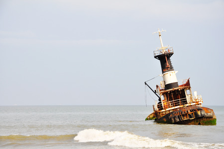 Rusted Shipwreck on the Beach since 1975 at the 'ship graveyard' of Barro Do Dande, Angola, Southern Africa