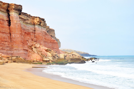 Beautiful Red Cliffs Edging the Tropical Coastline of Angola, Southern Africa Stock Photo