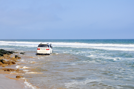Adventurous, Off-Road Driving Around the Rocks on the Acre of Death Along the Coast of Angola, Southern Africa Stock Photo