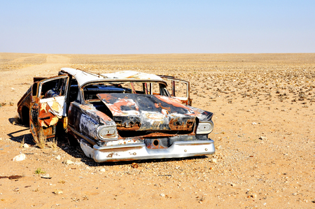 car wreck: Burnt Out Car Wreck Lonely and Abandoned in the Desert Plains of Angola, Southern Africa