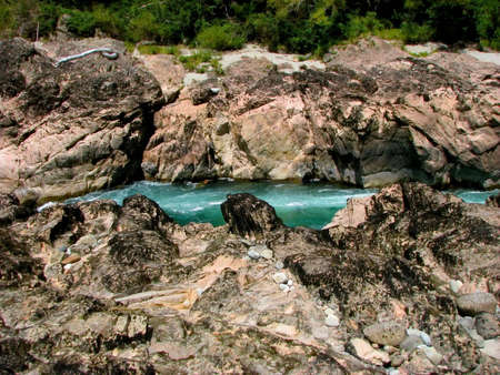 the deep south: The turquoise water streams between ruddy rocks.The Buller Gorge is a deep canyon  in the northwest of the South Island of New Zealand.  Stock Photo