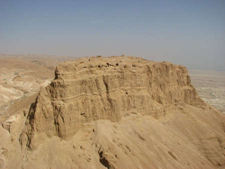 judean: Masada ( Metzada) is the fortress in the South District of Israel on top of an isolated rock plateau, or horst, on the eastern edge of the Judean Desert overlooking the Dead Sea.