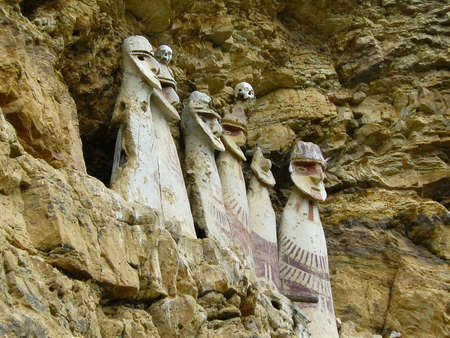 inaccessible: Carajia -  sarcophagi  Indians Chachapoyya. Sarcophagus Carajia - it sarcophagi, coffins for mummies, painted with natural dyes, standing on an inaccessible height on the rock. Located near Chachapoyas, Amazonas, Peru. Stock Photo