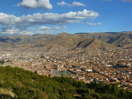 translates: Cuzco - the ancient capital of Peru. Cuzco, located in the Sacred Valley of Urubamba River, was capital of Inca empire. The citys name translates from Quechua language as the navel of the earth.