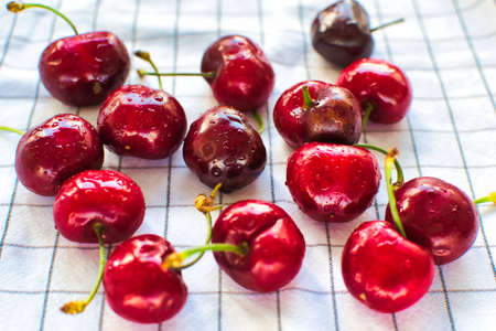 fresh cherries with water droplets on a white background
