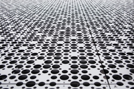 shifting: Abstract background metal black and white sircles panel in perspective with tilt shifting