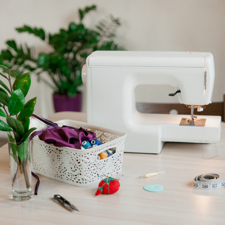 light minimalist work space for tailor white sewing machine stock