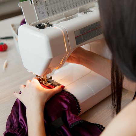 Female Hands On Sewing Machine Process Of Silk Lingerie Making Adorable Hands Free Sewing Machine