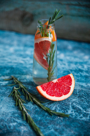 Infused water recipe. Grapefruit and rosemary detox water. Healthy lifestyle concept. Healthy habit of hydration.