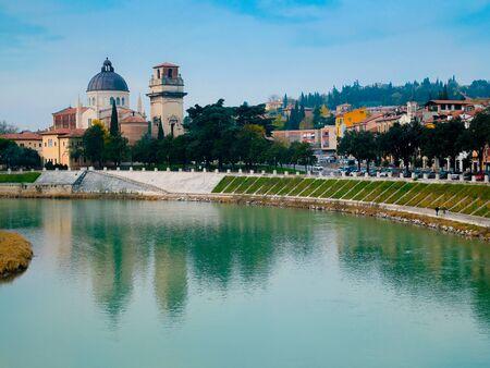 Cityscape of Verona with river Adige. Historical center of European city. Romantic sightseeng trip to Italy Archivio Fotografico - 129472027