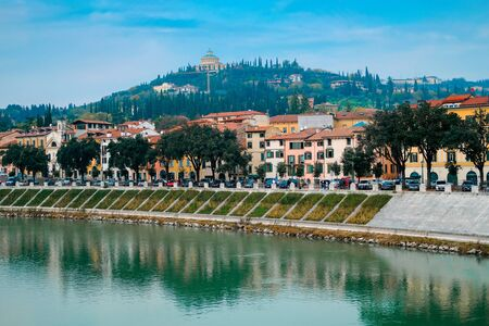 Cityscape of Verona with river Adige. Historical center of European city. Romantic sightseeng trip to Italy Archivio Fotografico - 129472029
