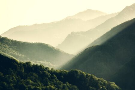 Sunset at Caucasus mountains in summer. Tonal perspective composition. Beautiful nature concept. Stockfoto - 129474156