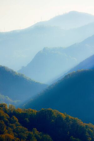 Sunset at Caucasus mountains in summer. Tonal perspective composition. Beautiful nature concept. 版權商用圖片